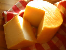 a wedge of cheese cut out of the round