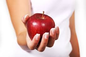 Pregnancy Diet lady holding an apple